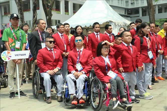 Đoàn Thể thao Người Khuyết tật Việt Nam tại Asian Para Games 2018 tham dự Lễ Thượng cờ.