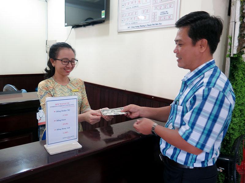 Điểm đổi ngoại tệ tại Khách sạn Hàm Luông, Phường 5, TP. Bến Tre. Ảnh: T. Thảo