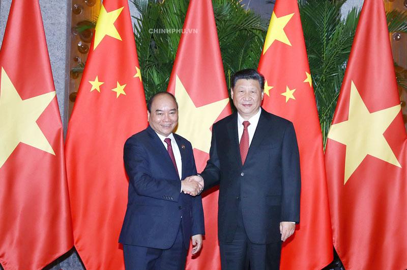 Thủ tướng Nguyễn Xuân Phúc và Tổng Bí thư, Chủ tịch Trung Quốc Tập Cận Bình. Ảnh: VGP/Quang Hiếu