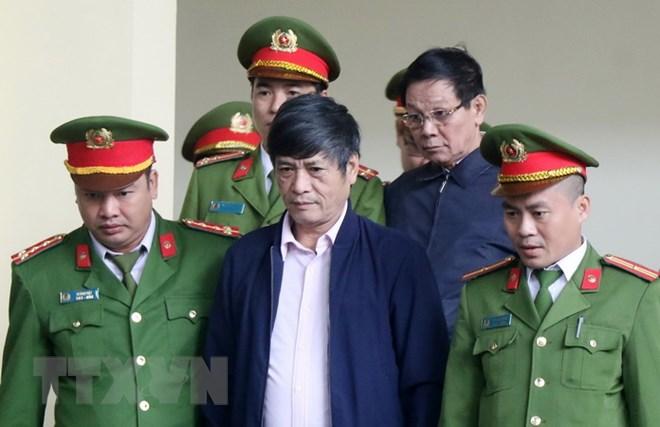 Bị cáo Nguyễn Thanh Hóa lĩnh án 10 năm tù, và Phan Văn Vĩnh lĩnh án 9 năm tù. Ảnh: Trung Kiên/TTXVN