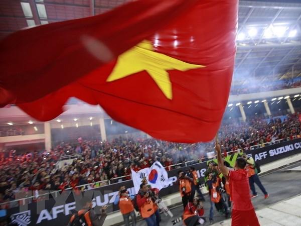 Quốc kỳ Việt Nam sẽ lại tung bay tại đấu trường Asian Cup 2019. Ảnh: Trọng Đạt/TTXVN