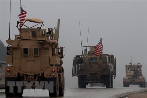 Đoàn xe quân sự Mỹ tại thành phố Manbij, miền bắc Syria, ngày 30-12-2018. Ảnh: AFP