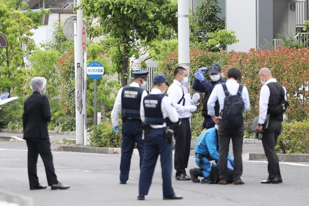 Cảnh sát điều tra tại hiện trường vụ tấn công tại thành phố Kawasaki, Nhật Bản. Ảnh: THX/TTXVN