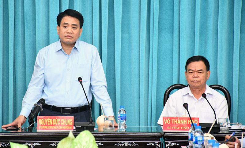 Đồng chí Nguyễn Đức Chung - Ủy viên Trung ương Đảng, Chủ tịch UBND TP. Hà Nội phát biểu tại buổi tiếp đón.