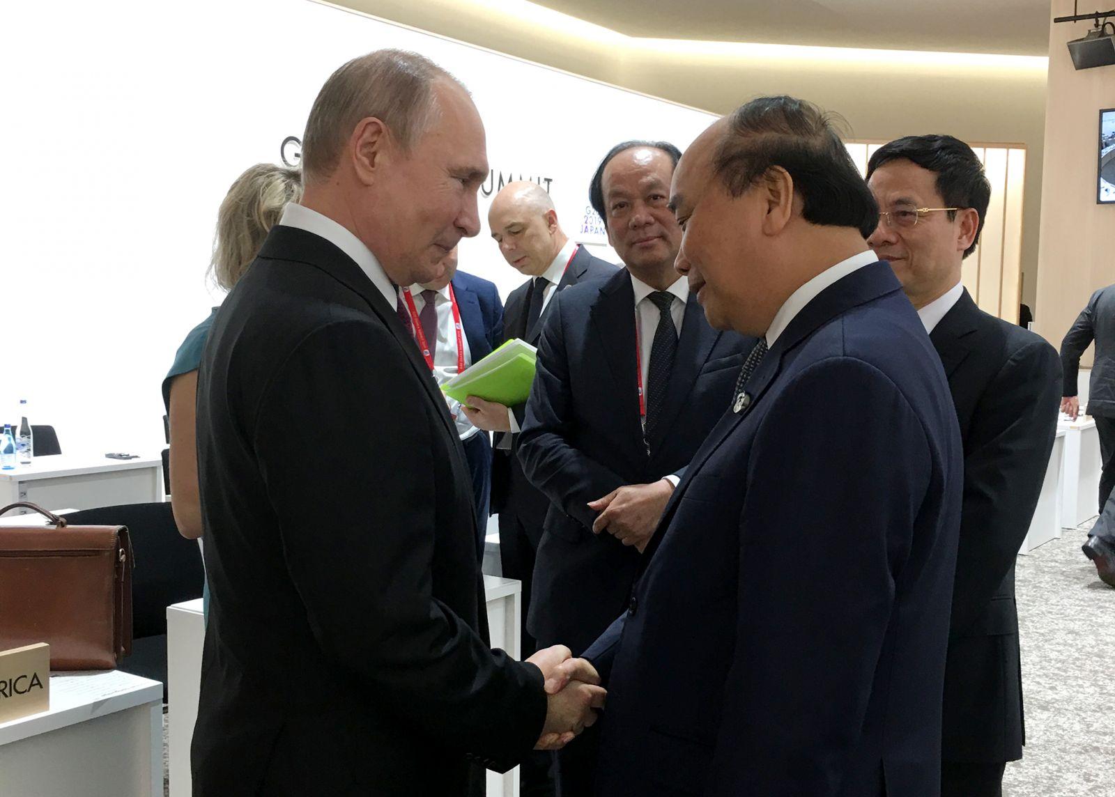 Thủ tướng Nguyễn Xuân Phúc và Tổng thống Nga Putin. Ảnh VGP/Quang Hiếu
