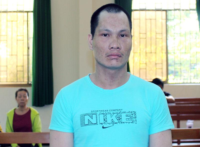 Bị cáo Trần Duy Quang tại phiên tòa hình sự sơ thẩm ngày 12-7-2019.