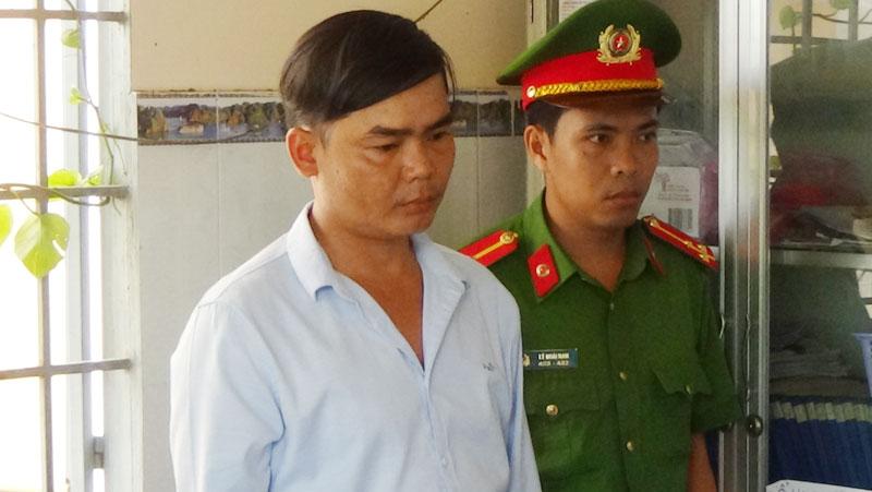 Đối tượng Lê Toàn Định tại cơ quan Công an.