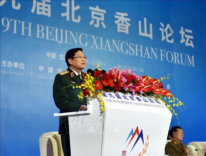 Đại tướng Ngô Xuân Lịch phát biểu, khẳng định lập trường của Việt Nam đối với vấn đề Biển Đông. Ảnh: Vĩnh Hà/Phóng viên TTXVN tại Trung Quốc