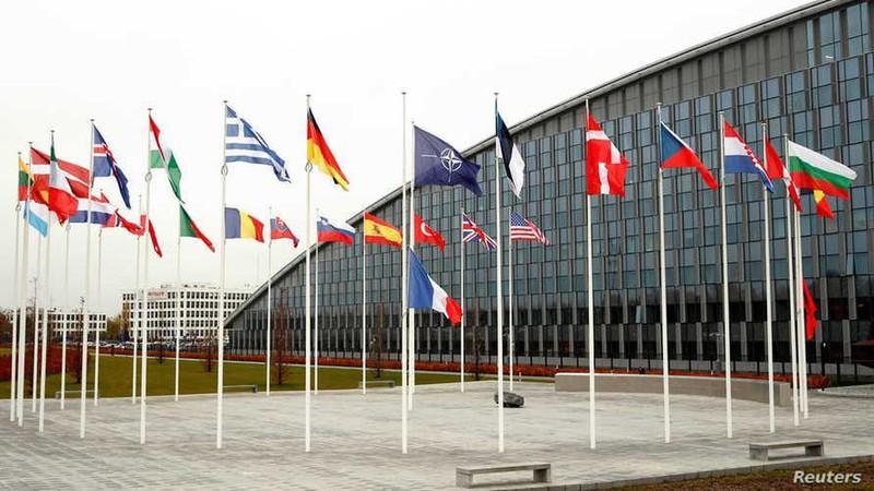 Cờ NATO và các nước thành viên. Ảnh: Reuters