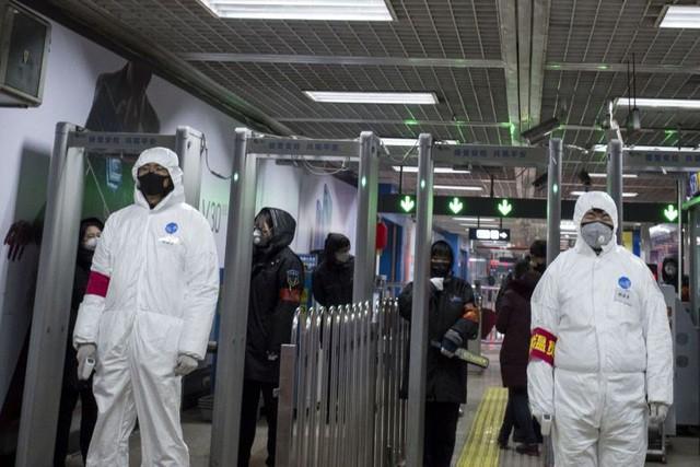 Trước diễn biến virus corona ngày càng lan rộng tại thành phố Vũ Hán của Trung Quốc, nơi được coi là trung tâm của dịch bệnh viêm phổi do virus corona gây ra. Ảnh minh họa/AFP