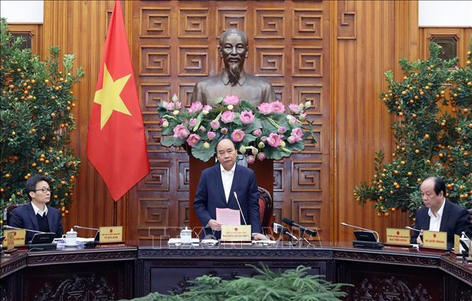 Thủ tướng Nguyễn Xuân Phúc chủ trì cuộc họp. Ảnh: Thống Nhất/TTXVN