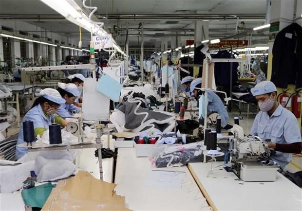 May hàng xuất khẩu tại Tổng Công ty may Đức Giang. Ảnh: Trần Việt/TTXVN