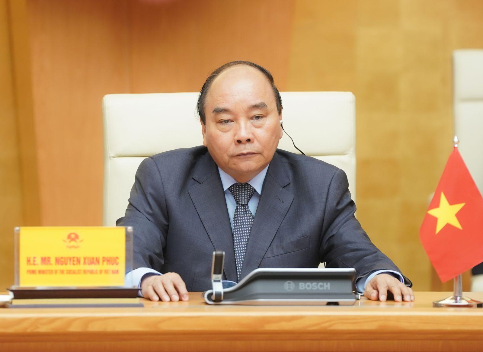 Thủ tướng Nguyễn Xuân Phúc dự Hội nghị Thượng đỉnh trực tuyến G20 ứng phó COVID-19. Ảnh: VGP/Quang Hiếu