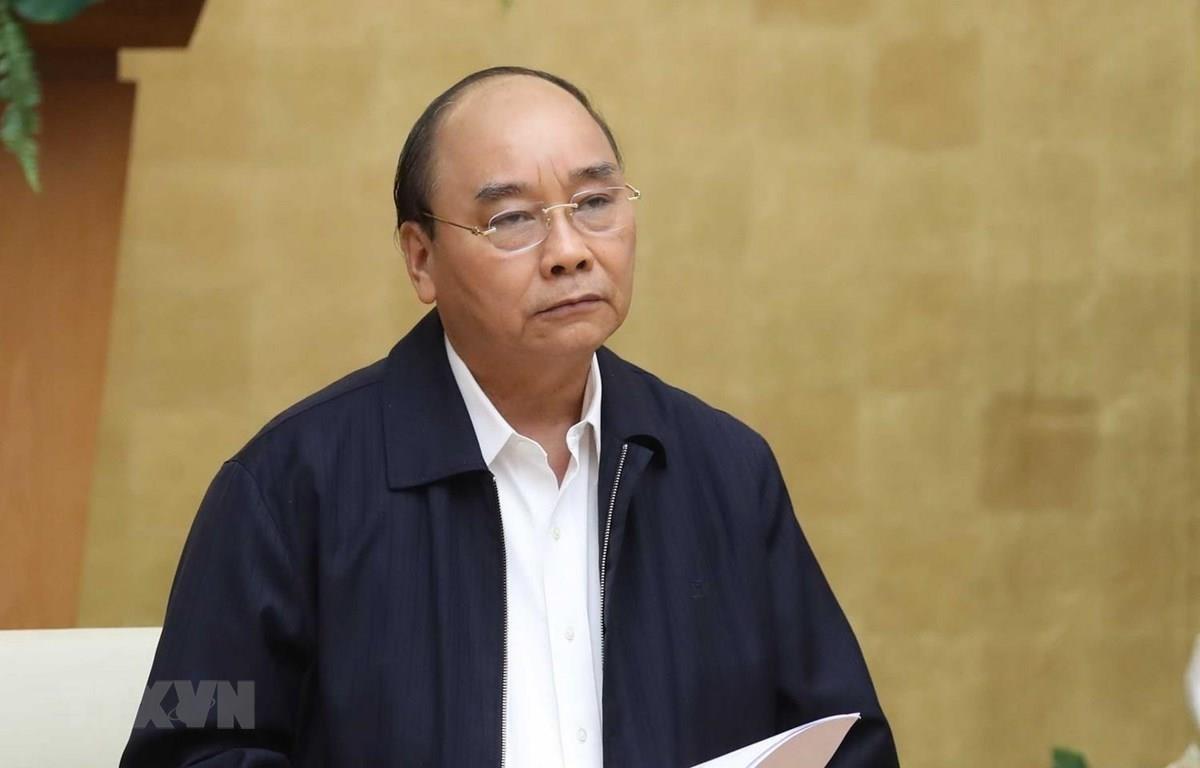 Thủ tướng Nguyễn Xuân Phúc chủ trì họp Thường trực Chính phủ với Ban Chỉ đạo Quốc gia phòng, chống dịch COVID-19. (Ảnh: Thống Nhất/TTXVN)