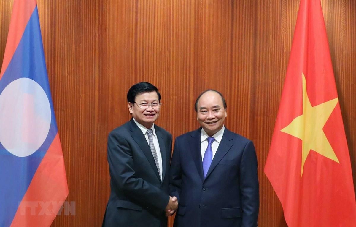 Thủ tướng Nguyễn Xuân Phúc hội đàm Thủ tướng Lào Thongloun Sisoulith. Ảnh: Thống Nhất/TTXVN