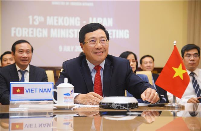 Phó Thủ tướng, Bộ trưởng Bộ Ngoại giao Phạm Bình Minh đồng chủ trì Hội nghị trực tuyến Bộ trưởng Mê Công - Nhật Bản lần thứ 13. Ảnh: Diễm Quỳnh/TTXVN phát