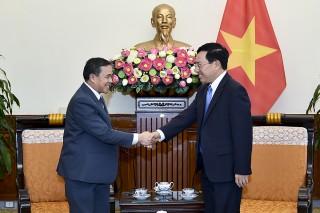 Phó Thủ tướng Phạm Bình Minh tiếp Đại sứ Lào